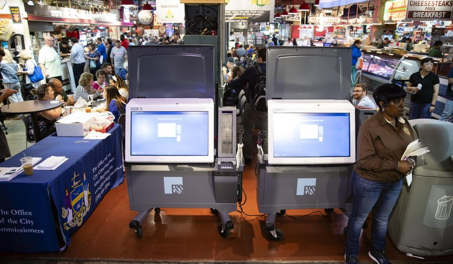 In this Thursday, June 13, 2019 photo, ExpressVote XL voting machines are displayed during a demonstration at the Reading Terminal Market in Philadelphia. The machines are made by Election Systems & Software, one of three voting-machine companies that disclosed to North Carolina election officials the substantial ownership stakes held by private equity firms  (AP Photo/Matt Rourke)