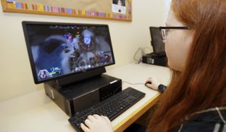 "Claire Hofstra plays ""Heroes of the Storm,"" at Hathaway Brown School, Wednesday, July 10, 2019, in Shaker Heights, Ohio. Hathaway Brown launched the country's first varsity esports program at an all-girls school. Coach J Collins hopes to encourage more girls to stick with video games through their teenage years, something that might have a ripple effect across an industry grappling with gender disparity. (AP Photo/Tony Dejak)"