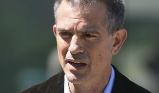 In this June 26, 2019 file photo, Fotis Dulos speaks after an appearance at Connecticut Superior Court in Stamford, Conn. Dulos is charged with evidence tampering and hindering prosecution in connection with the May 24 disappearance of his wife Jennifer Dulos. (Tyler Sizemore/Hearst Connecticut Media via AP, File)