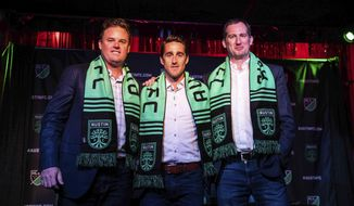 From left, Anthony Precourt, Josh Wolff and Andy Loughnane pose for a photo during a news conference in Austin on Tuesday, July 23, 2019. Former U.S. men's national team player and current assistant coach Josh Wolff will be the first head coach of Austin FC, the new Major League Soccer franchise that is scheduled to begin play in 2021. (Lola Gomez/Austin American-Statesman via AP)