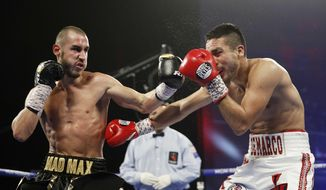 """FILE - In this Oct. 20, 2018, file photo, Maxim Dadashev, of Russia, left, hits Antonio DeMarco, of Mexico, during a junior welterweight bout  in Las Vegas. Maxim Dadashev has died after suffering a brain injury in a fight in Maryland. He was 28.The Russian Boxing Federation said Tuesday, July 23, 2019, that Dadashev died """"as a result of the injuries he sustained"""" in Friday's, July 19, 2019, light-welterweight fight with Subriel Matias at the Theater at MGM National Harbor in Oxon Hill, Maryland. (AP Photo/John Locher, File)"""