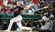 Washington Nationals' Trea Turner, left, watches his solo home run in front of Colorado Rockies catcher Chris Iannetta and umpire Jerry Meals in the first inning of a baseball game, Tuesday, July 23, 2019, in Washington. (AP Photo/Patrick Semansky)