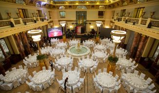 This photo taken on Thursday, Feb. 21, 2019 shows a view of the restaurant inside Moscow's iconic Metropol Hotel in Moscow, Russia. The Metropol, across the street from the Bolshoi Theater and 500 meters from Red Square, became a favorite with world leaders and celebrities. In 2009, U.S. President Barak Obama also gave a speech at the hotel. (AP Photo/Alexander Zemlianichenko)
