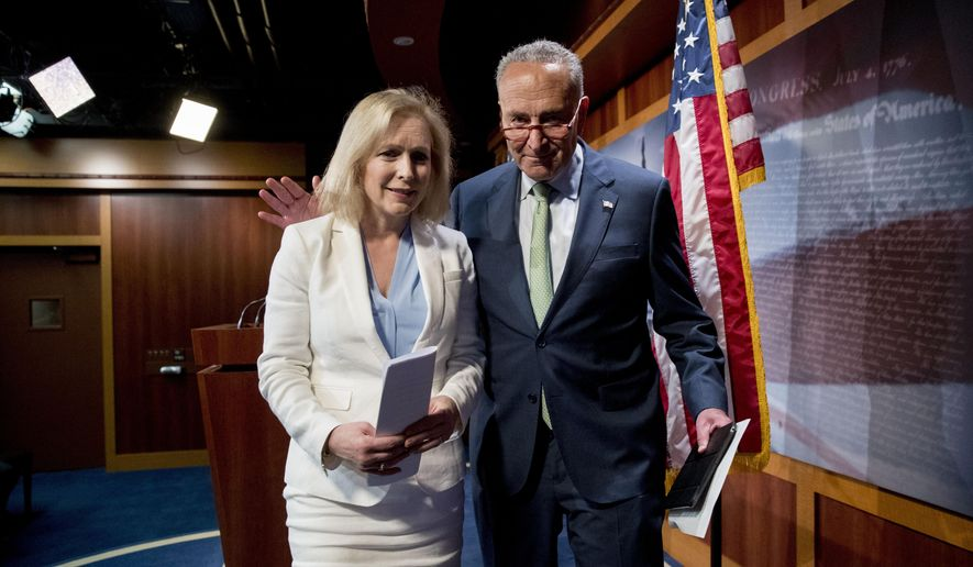 In this file photo, then-Senate Minority Leader Sen. Chuck Schumer of N.Y., and Democratic presidential candidate Sen. Kirsten Gillibrand, D-N.Y., depart a news conference on the 9/11 victims fund on Capitol Hill in Washington, Thursday, July 18, 2019. (AP Photo/Andrew Harnik)  **FILE**