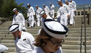 FILE - In this June 27, 2019, file photo, incoming plebes carry their belongings down a staircase during Induction Day at the U.S. Naval Academy, in Annapolis, Md. An analysis released Tuesday, July 23, 2019, shows the percentage of female students nominated by members of Congress for admission to U.S. service academies has been rising although men are still put forward at numbers nearly three times higher than women. (AP Photo/Patrick Semansky, File)