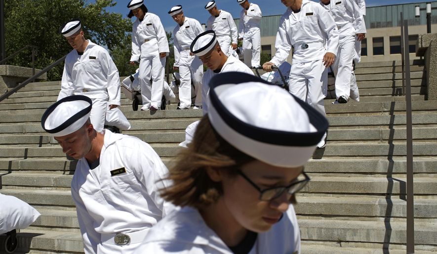 In this June 27, 2019, file photo, incoming plebes carry their belongings down a staircase during Induction Day at the U.S. Naval Academy, in Annapolis, Md. An analysis released Tuesday, July 23, 2019, shows the percentage of female students nominated by members of Congress for admission to U.S. service academies has been rising although men are still put forward at numbers nearly three times higher than women. (AP Photo/Patrick Semansky, File)