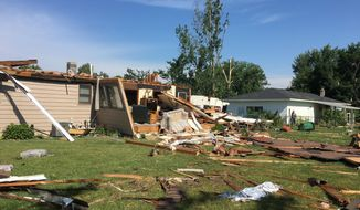A storm caused significant damage to a Jenison, Mich., neighborhood on Saturday, July 20, 2019, tearing the roof and some walls off one home. (John Tunison/The Grand Rapids Press via AP)