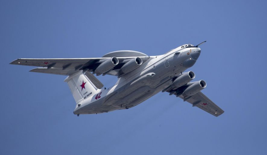 In this file photo taken on Tuesday, May 7, 2019, A Russian Beriev A-50 airborne early warning and control training aircraft flies over Red Square during a rehearsal for the Victory Day military parade in Moscow, Russia.  South Korean air force jets fired 360 rounds of warning shots after a Russian military plane briefly violated South Korea's airspace twice on Tuesday, Seoul officials said, in the first such incident between the two countries. (AP Photo/Alexander Zemlianichenko, Pool, File)