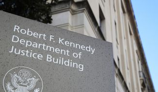 This Friday, March 22, 2019, file photo shows the Department of Justice Building in Washington. (AP Photo/Manuel Balce Ceneta) ** FILE **