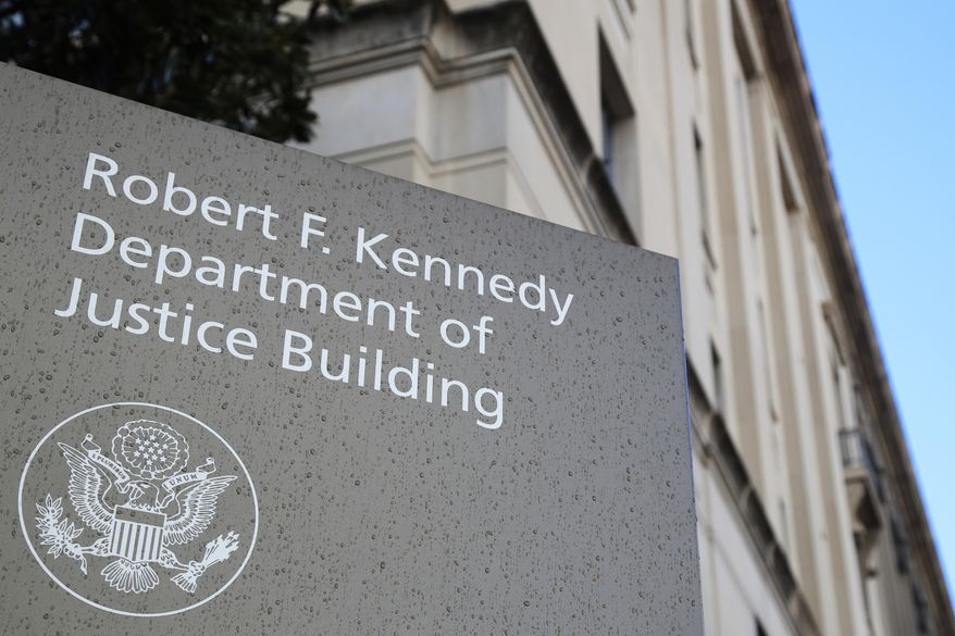This Friday, March 22, 2019, photo shows the Department of Justice Building in Washington. (AP Photo/Manuel Balce Ceneta) **FILE**