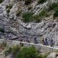 Wearing the overall leader's yellow jersey, France's Julian Alaphilippe rides among the pack during the 17th stage of the Tour de France on Wednesday. The stage started in Pont Du Gard and finished in Gap, France. (ASSOCIATED PRESS)