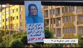 A Maryam Rajavi poster hangs from an overpass in a major expressway in Tehran. After stealing the identity of a French diplomat in Jerusalem, Iran had him tweet that Ms. Rajavi, head of the biggest Iranian dissident group, had visited archenemy Israel to set anti-Iran strategy.