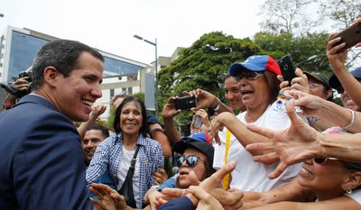 The next round of U.S. sanctions against Venezuela are coming, said special representative to Venezuela Elliott Abrams. Those sanctions give opposition leader Juan Guiado (left) leverage against President Nicolas Maduro. Opposition leader and self-proclaimed interim president of Venezuela Juan Guaido greets supporters at the end of a rally in Caracas, Venezuela, Tuesday, July 23, 2019. The National Assembly approved on Tuesday the return of Venezuela to the Inter-American Treaty of Reciprocal Assistance to strengthen cooperation with the countries of the region and raise pressure on President Nicolas Maduro. (AP Photo/Ariana Cubillos) (Associated Press)