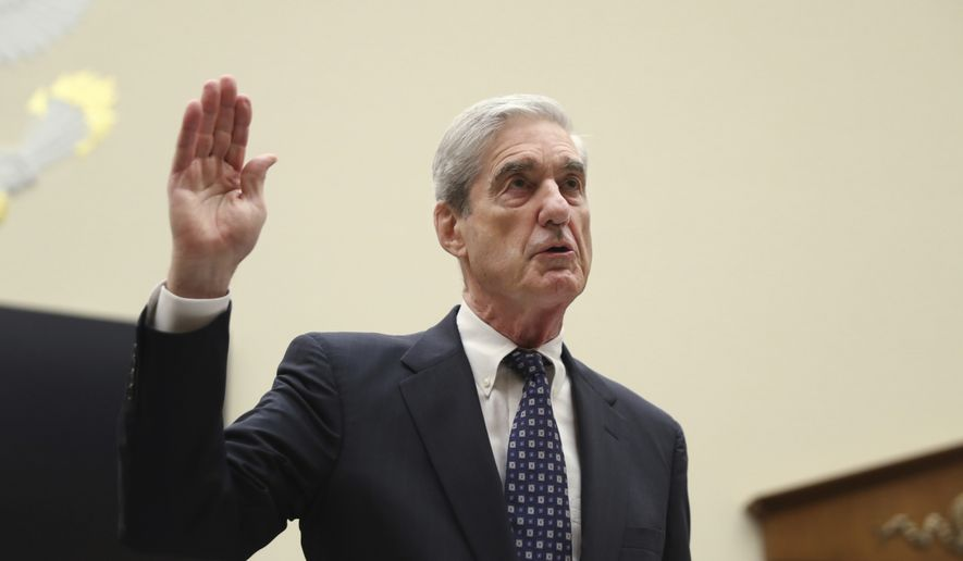 Former special counsel Robert Mueller, is sworn in before he testifies before the House Judiciary Committee hearing on his report on Russian election interference, on Capitol Hill, in Washington, Wednesday, July 24, 2019. (AP Photo/Andrew Harnik)