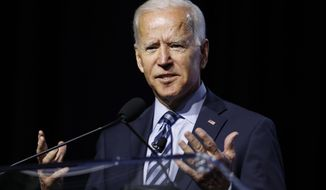 Democratic presidential candidate former Vice President Joe Biden, speaks during a candidates forum at the 110th NAACP National Convention, Wednesday, July 24, 2019, in Detroit. (AP Photo/Carlos Osorio)