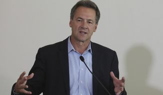 Montana Gov. Steve Bullock speaks during a news conference launching an Outdoors Recreation Initiative Wednesday, July 24, 2019, in Salt Lake City. (AP Photo/Rick Bowmer)