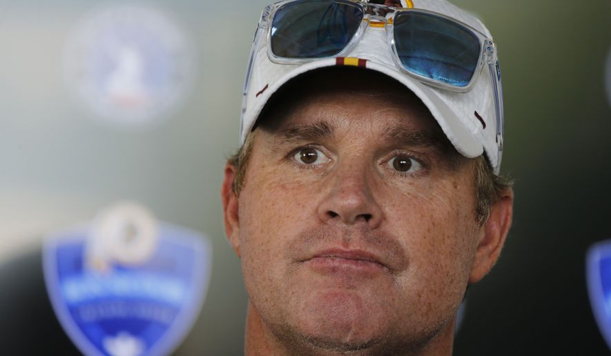 Washington Redskins head football coach, Jay Gruden, listens to a question during a news conference at the Redskins NFL training camp in Charlottesville, Va., Wednesday, July 24, 2019. (AP Photo/Steve Helber)