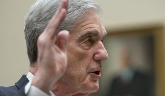 Former special counsel Robert Mueller is sworn in to testify to the House Judiciary Committee about his investigation into President Donald Trump and Russian interference in the 2016 election, on Capitol Hill in Washington, Wednesday, July 24, 2019. (AP Photo/J. Scott Applewhite)