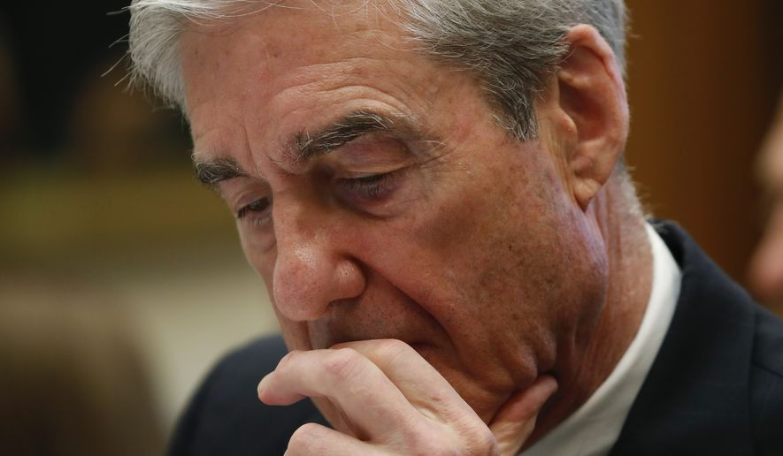 Former special counsel Robert Mueller, listens as testifies before the House Judiciary Committee hearing on his report on Russian election interference, on Capitol Hill, Wednesday, July 24, 2019 in Washington. (AP Photo/Alex Brandon)
