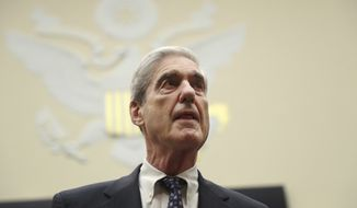 Former special counsel Robert Mueller, arrives to testify before the House Judiciary Committee hearing on his report on Russian election interference, on Capitol Hill, in Washington, Wednesday, July 24, 2019. (AP Photo/Andrew Harnik)