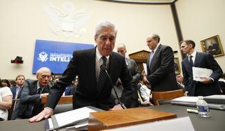 Former special counsel Robert Mueller returns from a break to continue to testify before the House Intelligence Committee hearing on his report on Russian election interference, on Capitol Hill, Wednesday, July 24, 2019, in Washington. (AP Photo/Alex Brandon)
