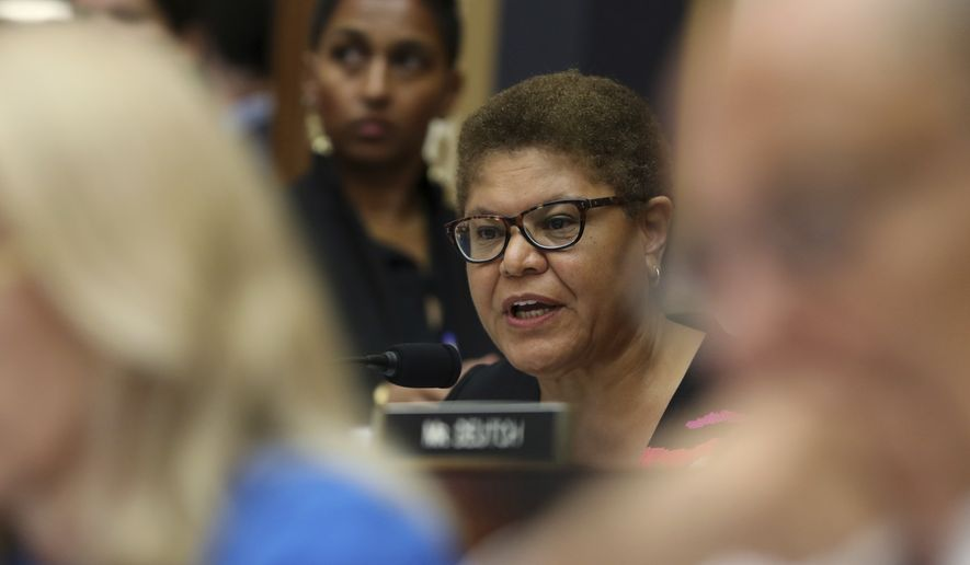 Rep. Karen Bass, D-Calif., asks questions to former special counsel Robert Mueller, as he testifies before the House Judiciary Committee hearing on his report on Russian election interference, on Capitol Hill, in Washington, Wednesday, July 24, 2019. (AP Photo/Andrew Harnik)