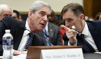 Former special counsel Robert Mueller, left, talks with his top aide in the investigation Aaron Zebley, right, during a House Judiciary Committee hearing on Capitol Hill in Washington, Wednesday, July 24, 2019, on on his report on Russian election interference. (AP Photo/Susan Walsh)