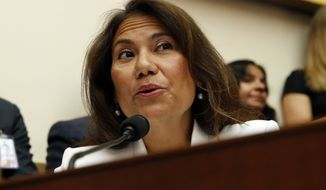 Rep. Veronica Escobar, D-Texas, questions former special counsel Robert Mueller as he testifies before the House Judiciary Committee hearing on his report on Russian election interference, on Capitol Hill, Wednesday, July 24, 2019 in Washington. (AP Photo/Alex Brandon)