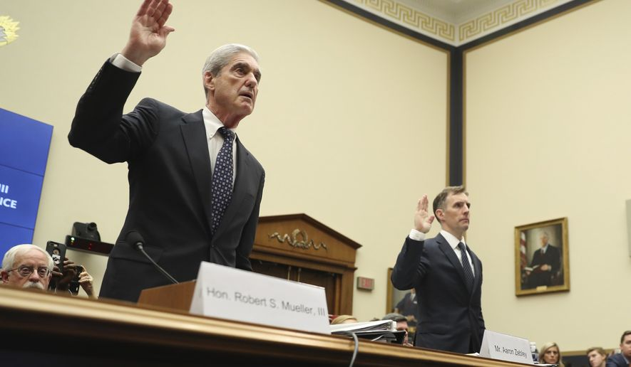 Former special counsel Robert Mueller, accompanied by his top aide in the investigation Aaron Zebley, right, are sworn in before testifying before the House Intelligence Committee hearing on his report on Russian election interference, on Capitol Hill, in Washington, Wednesday, July 24, 2019. (AP Photo/Andrew Harnik)