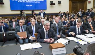 Former special counsel Robert Mueller, accompanied by his top aide in the investigation Aaron Zebley, is seated to testify before the House Intelligence Committee hearing on his report on Russian election interference, on Capitol Hill, Wednesday, July 24, 2019 in Washington. (AP Photo/Alex Brandon)