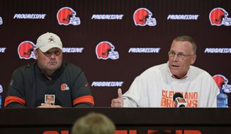 Cleveland Browns general manager John Dorsey, right, and head coach Freddie Kitchens answers questions during a news conference at the NFL football team's training camp facility, Wednesday, July 24, 2019, in Berea, Ohio. (AP Photo/Tony Dejak)