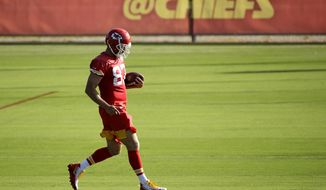 Kansas City Chiefs tight end Travis Kelce runs a drill during NFL football training camp Wednesday, July 24, 2019, in St. Joseph, Mo. (AP Photo/Charlie Riedel)