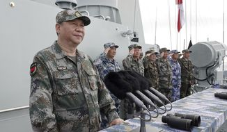 In this April 12, 2018, file photo released by Xinhua News Agency, Chinese President Xi Jinping speaks after reviewing the Chinese People's Liberation Army (PLA) Navy fleet in the South China Sea. (Li Gang/Xinhua via AP, File)