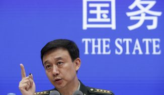 "Defense Ministry spokesman Wu Qian speaks during a press conference at the State Council Information Office in Beijing, Wednesday, July 24, 2019. China says it will not ""renounce the use of force"" in efforts to reunify Taiwan with the mainland and vows to take all necessary military measures to defeat ""separatists."" (AP Photo/Andy Wong)"