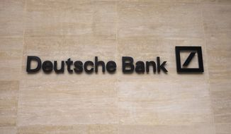 FILE - In this Monday, July, 8, 2019 file photo, a Deutsche Bank sign is seen on the outside of their building in London. Deutsche Bank releases second-quarter earnings on Wednesday, July 24. (AP Photo/Natasha Livingstone, file)