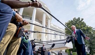 President Trump chats with the press outside the White House earlier this year. (AP Photo) ** FILE **