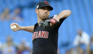 Cleveland Indians starting pitcher Shane Bieber (57) throws against the Toronto Blue Jays during the first inning of a baseball game, Wednesday, July 24, 2019 in Toronto. (Nathan Denette/Canadian Press via AP) ** FILE **