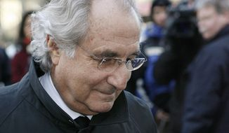 FILE - In this Jan. 14, 2009 file photo, Bernard Madoff arrives at Federal Court in New York. Madoff, who pleaded guilty in 2009 to orchestrating the largest Ponzi scheme in history, is seeking an early release from prison. The Department of Justice confirmed on Wednesday, July 24, 2019 that Madoff has a pending request to get his 150-year sentence reduced. (AP Photo/Stuart Ramson, File)