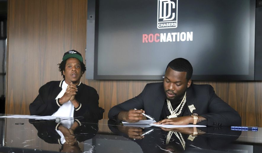 Jay-Z, left, and Meek Mill make an announcement of the launch of Dream Chasers record label in joint venture with Roc Nation, at the Roc Nation headquarters on Tuesday, July 23, 2019, in New York. (Photo by Greg Allen/Invision/AP)