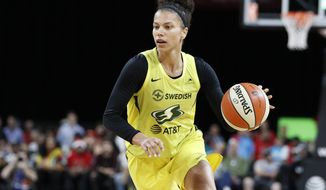 Seattle Storm's Alysha Clark drives against the Las Vegas Aces during the second half of a WNBA basketball game, Tuesday, July 23, 2019, in Las Vegas. (AP Photo/John Locher)