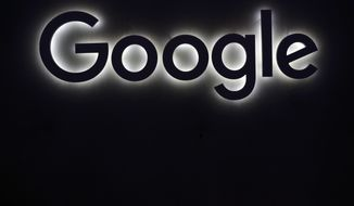 FILE - This Friday, June 16, 2017, file photo shows the Google logo at a gadgets show in Paris. As Google becomes a leading mail provider, search engine and advertising platform, federal regulators are starting to wonder if it needs to be knocked down a bit. (AP Photo/Thibault Camus, File)