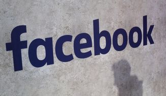 This Jan. 17, 2017, file photo shows a Facebook logo displayed at a business gathering in Paris. On August 8, 2019, the Ninth U.S. Circuit Court of Appeals allowed a class action lawsuit against Facebook over its face-recognition software to move forward. (AP Photo/Thibault Camus, File) **FILE**