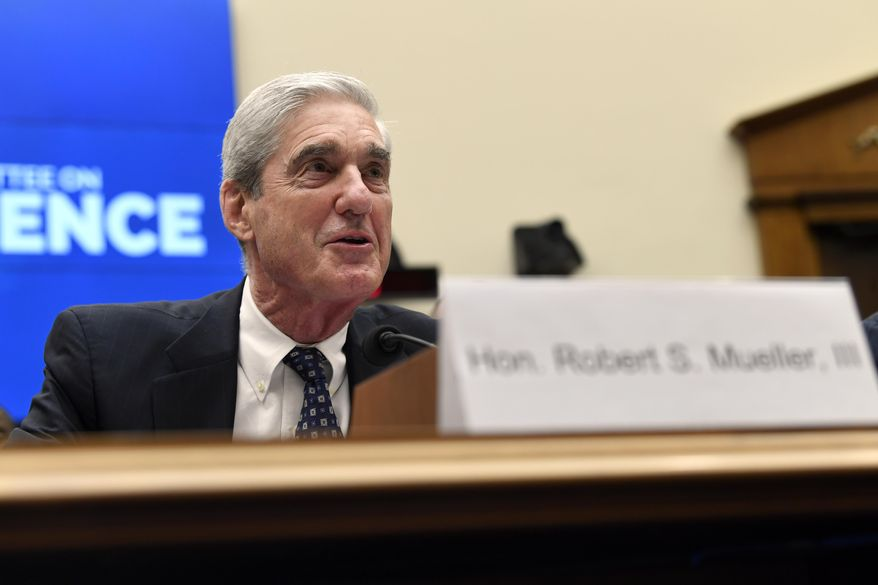 Former special counsel Robert Mueller testifies before the House Intelligence Committee on Capitol Hill in Washington, Wednesday, July 24, 2019, during a hearing on his report on Russian election interference. (AP Photo/Susan Walsh)