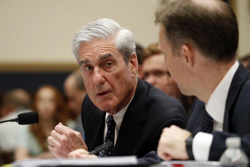 Former special counsel Robert Mueller, accompanied by his top aide in the investigation Aaron Zebley, right, testifies before the House Intelligence Committee hearing on his report on Russian election interference, on Capitol Hill, Wednesday, July 24, 2019 in Washington. (AP Photo/Alex Brandon)
