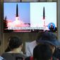 People watch a TV showing North Korea's missile launch in Seoul, South Korea, on Thursday. North Korea fired two projectiles, South Korea's military said, the first launches in over two months as North Korean and U.S. officials struggle to restart diplomacy. (Associated Press)