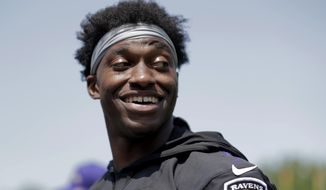 Baltimore Ravens quarterback Robert Griffin III looks on during NFL football training camp, Thursday, July 25, 2019, in Owings Mills, Md. (AP Photo/Julio Cortez)