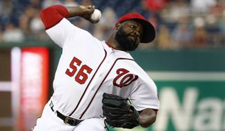 Washington Nationals relief pitcher Fernando Rodney throws to the Colorado Rockies in the ninth inning of a baseball game, Thursday, July 25, 2019, in Washington. Colorado won 8-7. (AP Photo/Patrick Semansky)