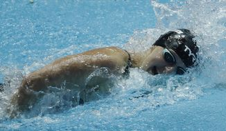 United States' Katie Ledecky swims her leg of the women's 4x200m freestyle relay at the World Swimming Championships in Gwangju, South Korea, Thursday, July 25, 2019. (AP Photo/Lee Jin-man )