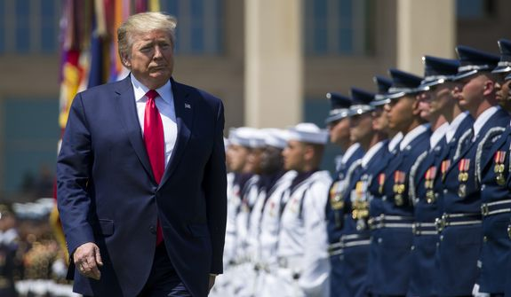 President Donald Trump reviews the troops during a full honors welcoming ceremony for Secretary of Defense Mark Esper at the Pentagon, Thursday, July 25, 2019, in Washington. (AP Photo/Alex Brandon)