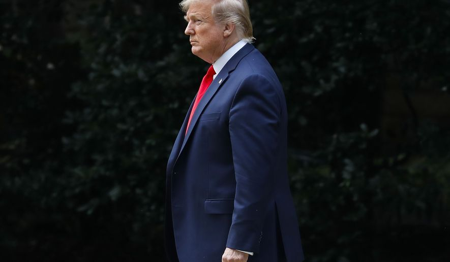 President Donald Trump walks out of the Oval Office of the White House in Washington prior to speaking to members of the media, Wednesday, July 24, 2019. (AP Photo/Pablo Martinez Monsivais)